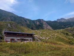 The view of Rifugio Prandini Franco with mountains on background, Braone Valley, Lombardy, Italy.