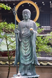 The view of the Bronze Buddha Statue in front of Daiun-in Buddhist Temple. Kyoto. Japan