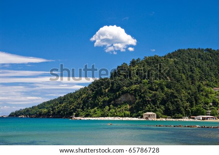 the view of the headland from a beach-side taverna on thassos, greece