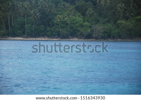 the view of the ocean and the island during the day is very sunny. photo taken around the Maluku islands, Indonesia #1516343930