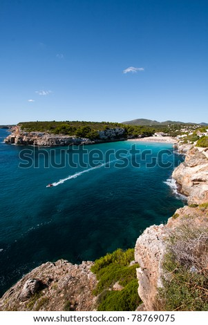 The view on beautiful lagoon with boat in the gulf of Majorca island