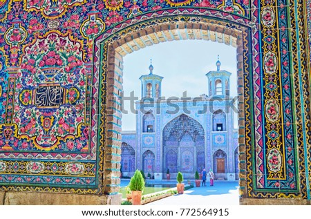 The view on the portal of Nasir Ol-Molk mosque with two small minarets and muqarnas decoration, Shiraz, Iran. #772564915
