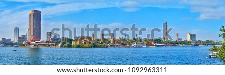 The view on the riverside quarters of Gezira Island with casinos, gardens, luxury hotels and Cairo Tower on background, Egypt. #1092963311