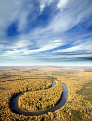 The View overhand of forest river by autumn solar day.