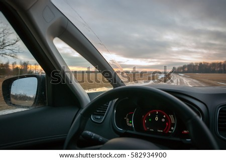 The view through car windscreen. Driving during sunset on the country road. #582934900