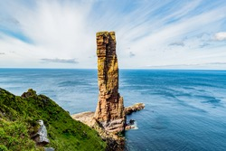 The view to the cliffs at The Old Man of Hoy  sea stack on Hoy, part of the Orkney archipelago off the north coast of Scotland