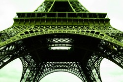 The view underneath the Eiffel Tower, Paris. Famous man-made structure. Paris attraction. Lightroom edited.