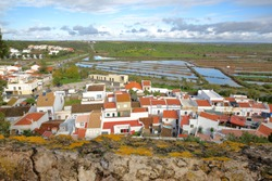 The village of Castro Marim viewed from the castle and with Sapal natural reserve in the background, Castro Marim, Algarve, Portugal