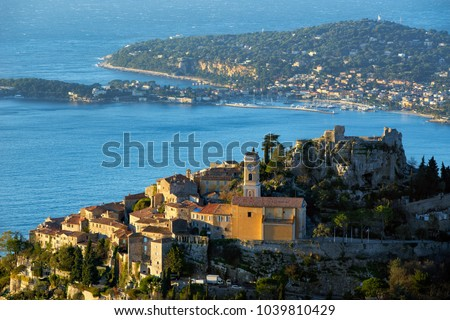 The Village of Eze (Ã?ze), the Mediterranean Sea and Saint-Jean-Cap-Ferrat at sunrise. Alpes-Maritimes, French Riviera, Cote d'Azur, France