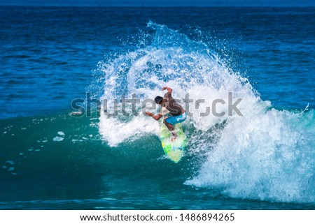 The Village Of Montanita. Ecuador. Pacific ocean. Surfer training. The athlete does tricks on the longboard. Surfer riding the wave. Aquatics. Extreme sport. The Beach Of Montanita. Surfing in Ecuador #1486894265