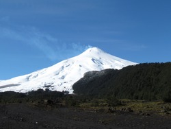 The Villarrica volcano park, the smoke at the top of the great mountain, the great snowy hill in the city of Pucón in Araucania in Chile.