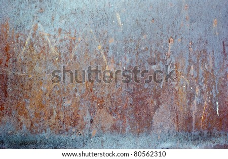 The vintage colored grunge iron textured background