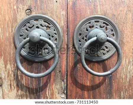 The Vintage Door Knocker, Door Handle On A Wooden Door, Thai Style.