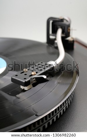 The vinyl record in the record-player #1306982260