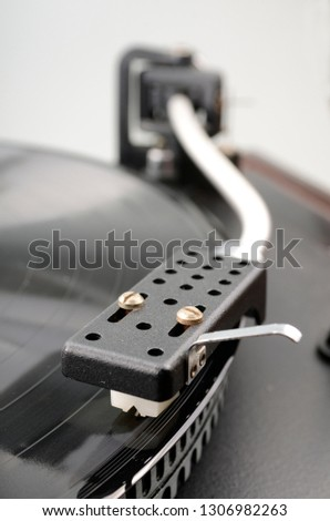 The vinyl record in the record-player #1306982263