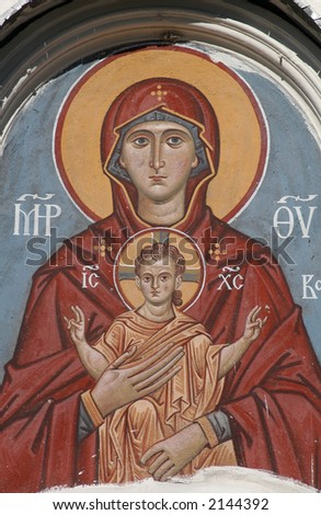 The Virgin and Child, an ancient fresco above the gate of an orthodox church in Pskov, Russia.