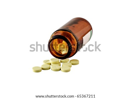 The vitamins scattered from a bottle as tablets
