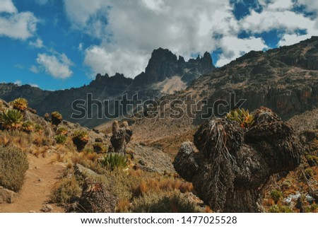 The Volcanic rock formations against a cloudy sky at Mount Kenya, Kenya