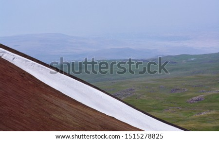 The volcanic soil, the everlasting ice and a landscape view towards Geghama mountains and beyond #1515278825