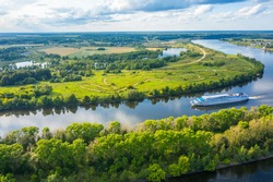 The Volga River, Russia. Tourist steamer floating on the Volga river channel, view from the quadcopter