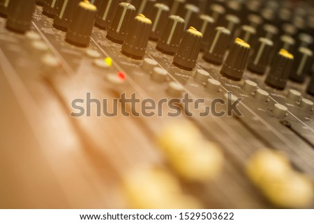 The volume buttons control the volume of the audio mixer abstract background.