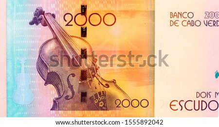 the Voz d'Amor album behind Violet and the sunset over the sea. portrait from Cape Verde 2000 Escudos 2014 Bank note, Cape Verde money. Closeup Collection. #1555892042