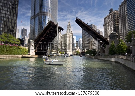 The Wabash Avenue bridge on the Chicago River is raised to allow the passage of sailboats on the final sail of the season from their harbor in Lake Michigan to their winter dry dock destination.