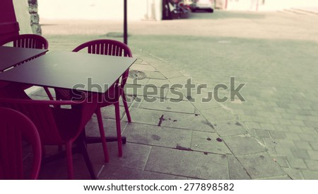 The waiting time table with chairs on market place