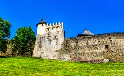 The wall and tower of the old stone fortress. Fortress wall tower. Wall tower of fortress
