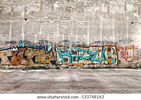 the wall decorated with colorful abstract graffiti
