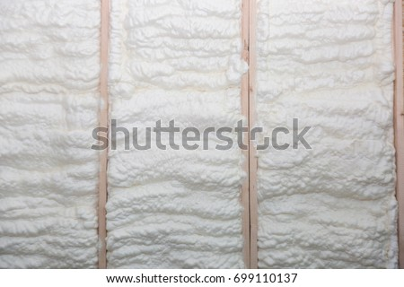 The wall of a new wooden house in foam for insulation and heat #699110137