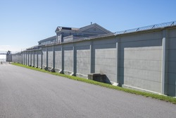 The wall of a prison disappears into the distance in Kingston Ontario Canada.