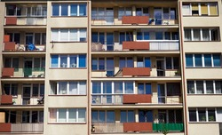 The wall of a residential building at the front and at an angle, the problem of the existence of an individual in the urban tissue, the repetition of simple geometric shapes, socialist and communist