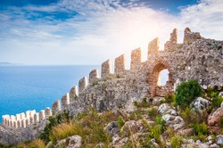 The wall of an ancient fortress on the hill in Alanya, Turkey. Beautiful summer landscape