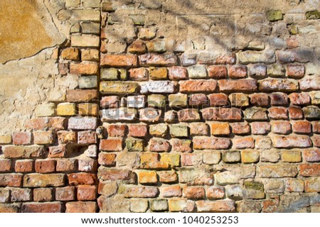 The wall of an old brick house. Background, texture, building.