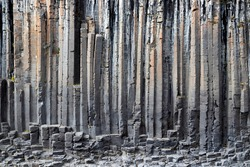 The wall of basalt columns in Studlagil canyon in Jokuldalur Valley in Iceland. Texture of a volcanic basalt rock.