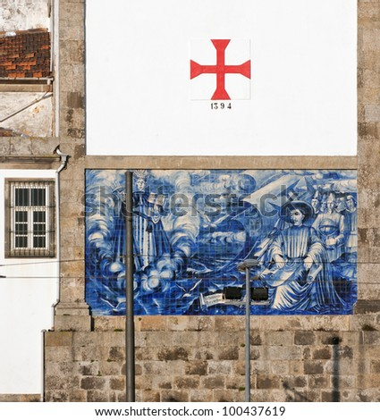 The wall of the ancient Church with a picture of azulejos on the shore of the Douro river - Porto, Portugal