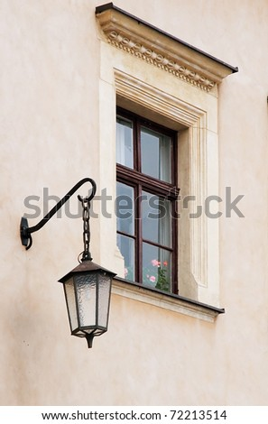 The Wall of Wawel Castle. Wall with window and street lamp.