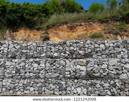 The wall protects from the erosion of rocks on the slopes. (ROCK SLOPE STABILIZATION) #1221242008