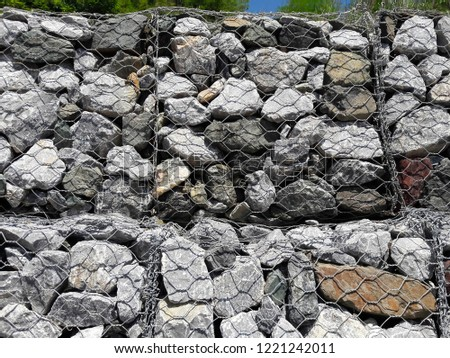 The wall protects from the erosion of rocks on the slopes. (ROCK SLOPE STABILIZATION) #1221242011