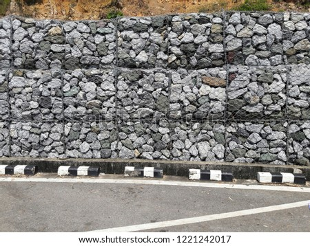 The wall protects from the erosion of rocks on the slopes. (ROCK SLOPE STABILIZATION) #1221242017