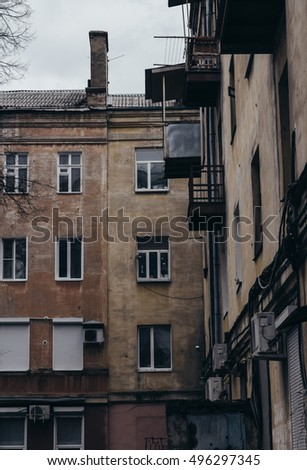 the walls and Windows of the old residential apartment house #496297345