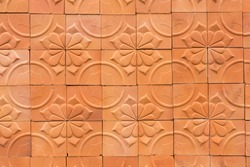 The walls decorated with terracotta tiles