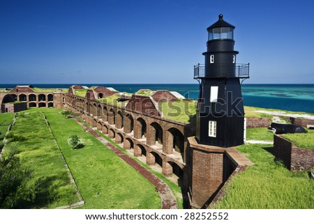 The walls of Fort Jefferson are situated on a tropical Garden Key, presently a part of Dry Tortugas National Park.