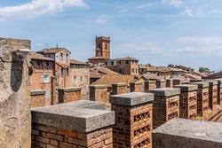 The walls of the La Torre del Mangia, Piazza del Campo, Palazzo Pubblico. Siena, Italy.
