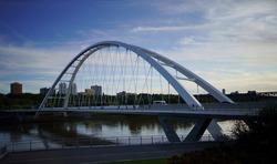 The Walterdale Bridge is a through arch bridge across the North Saskatchewan River in Edmonton, Alberta, Canada. It replaced the previous Walterdale Bridge in 2017.