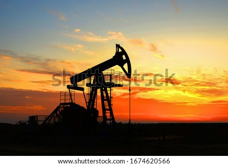The war on oil prices caused by the coronavirus. Oil prices fall due to global crisis. Oil drilling derricks at desert oilfield. Crude oil production from the ground. Petroleum production, natural gas
