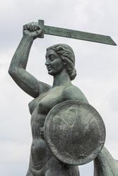 The Warsaw Mermaid called Syrenka on the Vistula River bank in Warsaw, Poland