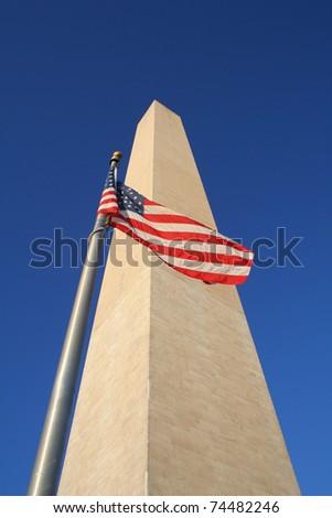 The Washington Monument and American Flag in Washington DC. - stock photo