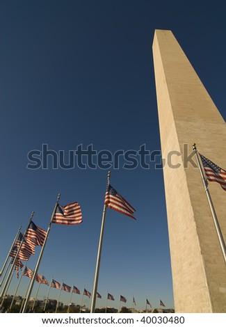 The Washington Monument  with the American flags. Located in Washington DC.